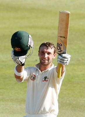 Australia's Phil Hughes celebrates his century during the third day of the second cricket test match against South Africa in Durban in this March 8, 2009 file photo. Former Australia batsman Hughes was rushed to a Sydney hospital on November 25, 2014 after being struck by a short delivery when batting for South Australia in a Sheffield Shield match