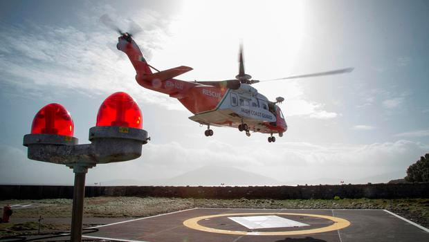 A Coast Guard Helicopter lands at Blacksod Lighthouse today. PIC COLIN O'RIORDAN
