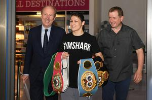 SAY CHEESE: Katie Taylor is greeted by Minister for Sport Shane Ross (l) at Dublin Airport last last June. Photo: Harry Murphy/Sportsfile