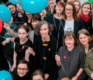 Campaign Director Lian Bell with actors, writers, academics, and business and community leaders gather on the Rosie Hackett Bridge before the final major public event at the AbbeyTheatre in the #WakingTheFeminists yearlong campaign for gender equality in Irish theatre. Photo: Kyran O'Brien