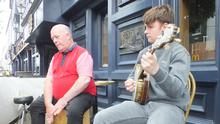 Musicians Johnny Bongos Horgan and Eoin Turner performing at the Hibernian Hotel on Saturday to mark Heritage Week. Photo: Eugene Cosgrove