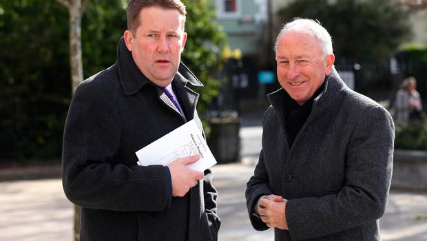Darragh O'Brien, TD and former Minister, Dermot Ahern outside St. Sylvester's Parish Church, Malahide before the funeral of Maureen Haughey. Credit: Damien Eagers