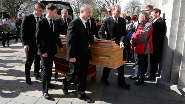 Sean, left and Ciaran Haughey, stand by as the coffin enters St. Sylvester's Parish Church, Malahide at the funeral of his mother, Maureen Haughey. Credit: Damien Eager