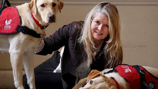 Nuala Geraghty, from the AADI with Autism assistance dogs, Trixie and Pearl.