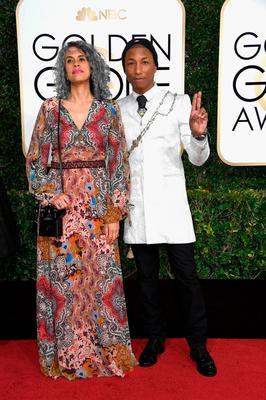 Musician Pharrell Williams (R) and Helen Lasichanh attend the 74th Annual Golden Globe Awards at The Beverly Hilton Hotel on January 8, 2017 in Beverly Hills, California.  (Photo by Frazer Harrison/Getty Images)