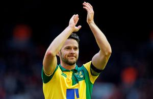 Norwich's on-loan winger Matthew Jarvis applauds fans after the game