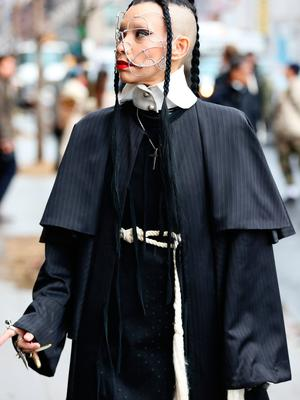 A guest is seen wearing a black and white dress, with a white rope belt and silver mask outside of the Coach 1941 show during New York Fashion Week on February 11, 2020 in New York City. (Photo by Donell Woodson/Getty Images)