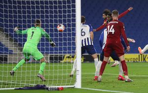 Liverpool's Mohamed Salah scores their third goal in the Premier League clash with Brighton at the Amex Stadium, Brighton.
