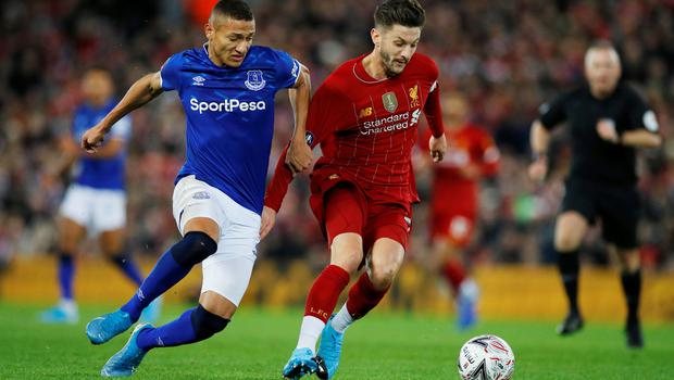 Liverpool's Adam Lallana and Everton's Richarlison jossle for possession. Both clubs are set to meet again on the opening weekend of the restarted Premier League. Photo: REUTERS/Phil Noble