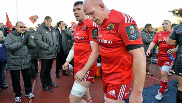 17 January 2015; Munster players Peter O'Mahony, left, and Paul O'Connell leave the pitch after the game. European Rugby Champions Cup 2014/15, Pool 1, Round 5, Saracens v Munster. Allianz Park, London, England. Picture credit: Brendan Moran / SPORTSFILE
