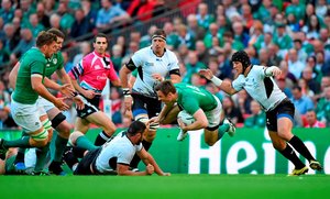 27 September 2015; Tommy Bowe, Ireland, is tackled by Valentin Poparlan, Romania. 2015 Rugby World Cup, Pool D, Ireland v Romania, Wembley Stadium, Wembley, London, England. Picture credit: Stephen McCarthy / SPORTSFILE