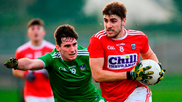 Ian Maguire of Cork in action against Darragh Treacy of Limerick. Photo by Ramsey Cardy/Sportsfile