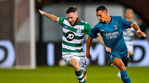 At arm's length: Jack Byrne of Shamrock Rovers tries to hold off AC Milan's Ismael at Tallaght Stadium. Photo: Sportsfile