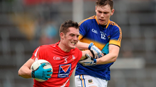 Declan Byrne, Louth, in action against Liam Casey, Tipperary