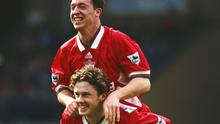 Robbie Fowler and Steve McManaman celebrate a goal during a Premier League clash against Manchester City at Maine Road on April 14, 1995. Photo by Gary M. Prior/Allsport UK/Getty Images