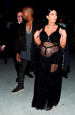 Rapper Kanye West (L) and television personality Kim Kardashian attend the Givenchy fashion show during Spring 2016 New York Fashion Week at Pier 26 at Hudson River Park on September 11, 2015 in New York City.  (Photo by Michael Loccisano/Getty Images)