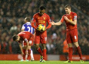 Liverpool's Steven Gerrard hands the ball to team-mate Daniel Sturridge (left) to take a penalty kick which he blazed over
