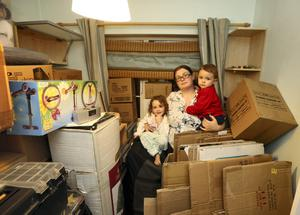 Julie Fitzsimons in one upstairs room of her home in Glenbrook, Limerick, with her children Maia(3) and Nikolas (18months) as she packs  to emigrate to join her husband Ziggy in England. Picture Liam Burke/Press 22