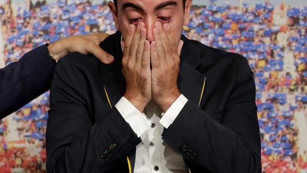 Xavi reacts during his farewell event at the Camp Nou stadium