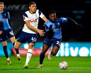 Wycombe's Fred Onyedinma looks to break past Tottenham's Carlos Vinícius. Photo: Getty Images