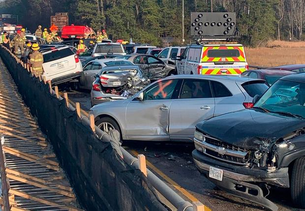 This handout image released by the Virginia State Police on Twitter shows damaged cars after an accident on the I-64 highway in York county near Williamsburg, Virginia, on December 22, 2019.(Photo by Handout / Virginia State Police / AFP)