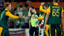 Ireland's George Dockrell reacts after being bowled for 25 runs by South Africa's Morne Morkel to end their Cricket World Cup match at Manuka Oval in Canberra.