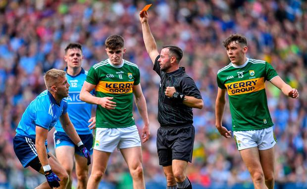 OFF: David Gough gives Jonny Cooper his marching order in the drawn football decider. Photo: Piaras Ó Mídheach/Sportsfile
