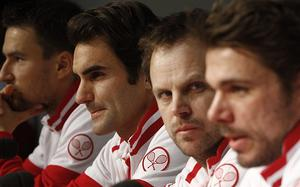 Together again: Roger Federer (centre) sits two places along from Stanislas Wawrinka (far right) at a Davis Cup press conference on Tuesday