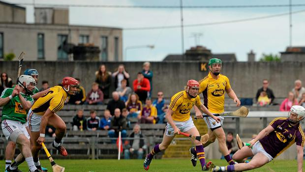 Wexford goalkeeper Mark Fanning saves a shot from Westmeath's Alan Devine, left