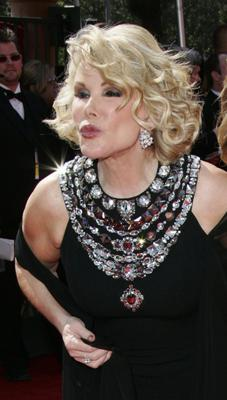 In this Sept. 18, 2005 file photo, comedian Joan Rivers blows kisses on arrival at the Primetime Emmy Awards in Los Angeles