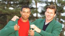 Tigers Woods receives his first green jacket from Nick Faldo  after the 1997 Masters in Augusta. Photo: Steve Munday/Allsport