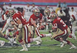 Joe Montana #16, Quarterback for the San Francisco 49ers hands the ball off to running back #33 Roger Craig during the Super Bowl XVIII game against the Cincinnati Bengals in January 1989 (Photo by Rick Stewart/Allsport/Getty Images)