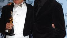 Robin Williams, winner of the Cecil B. DeMille Award, and presenter Pierce Brosnan (Photo by SGranitz/WireImage)