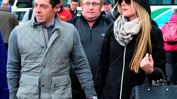 Rory McIlroy of Northern Ireland arrives at the course with new girlfriend Erica Stoll during the fourth round of the Dubai Duty Free Irish Open hosted by the Rory Foundation at Royal County Down Golf Club on May 31, 2015 in Newcastle, Northern Ireland. (Photo by Mark Runnacles/Getty Images)