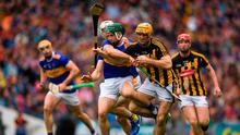 Colin Fennelly of Kilkenny  is tackled by Cathal Barrett of Tipperary