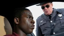 Damson Idris, on left, is repeatedly harassed by Glenn Fleshler's racist cop in The Twilight Zone revival