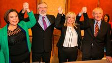 Mary Lou McDonald, Gerry Adams, Michelle O'Neill and Martin McGuinness raise their hands together after Ms O'Neill's selection as the newly appointed Stormont leader for Sinn Féin. Photo: PA