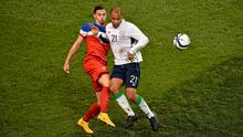 Ireland debutant David McGoldrick tussles with USA defender Geoff Cameron during their friendly at the Aviva. Photo: Barry Cregg / SPORTSFILE