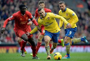 Liverpool's Kolo Toure challenges Arsenal's Jack Wilshere