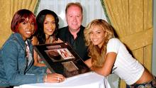 DJ Tony Fenton is photographed presenting Michelle Williams, Kelly Rowland and Beyonce Knowles, members of 'Destiny's Child' with an award to celebrate their album reaching double platinum sales in Ireland.