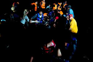 Syrian refugees arrive aboard a dinghy after crossing from Turkey, to the island of Lesbos, Greece, on Saturday, Sept. 19, 2015. (AP Photo/Petros Giannakouris)