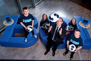 Martin O'Neill with Pearse Rangers U11's stars Daniel Harris, left, and Kyle Smith with Cambridge Girls U11's players Brooke Carr, left, and Abbie Cassidy. Bank of Ireland, Grand Canal Square