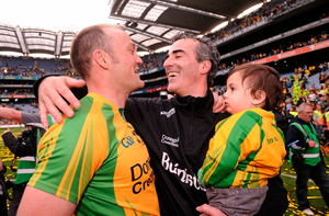 Jim McGuinness celebrates with his son Jimmy and Colm McFadden after their All-Ireland final triumph against Mayo. Picture credit: David Maher / Sportsfile