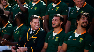 South Africa's head coach Rassie Erasmus (bottom C) joins players as they take part in a photo session on the eve of their final against England at the team's hotel in Urayasu near Tokyo on November 1, 2019. (Photo by CHARLY TRIBALLEAU/AFP via Getty Images)
