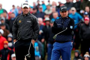 Lee Westwood (left) and Graeme McDowell on the 18th green during day one of the Dubai Duty Free Irish Open at Royal County Down Golf Club, Newcastle. Brian Lawless/PA Wire.