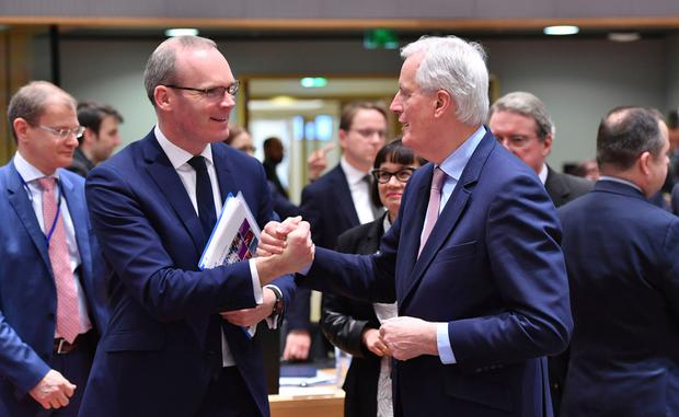 Foreign Affairs Minister Simon Coveney with EU chief negotiator Michel Barnier. Photo: AP