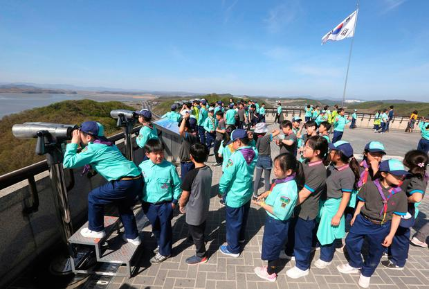 School students stand in lines to watch the North Korea side from the unification observatory in Paju, South Korea. Photo: AP/Ahn Young-joon