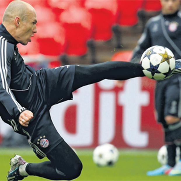 Arjen Robben volleys the ball during Bayern Munich's training session at Wembley ahead of tonight's Champions League final