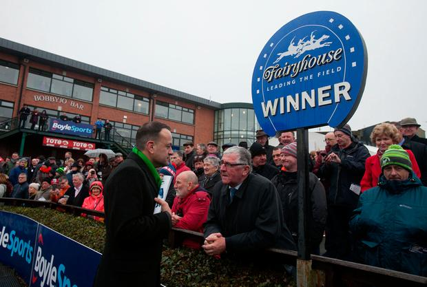 Leo Varadkar speaking to ex-FG politician Tom Hayes at the Irish Grand National at Fairy. Photo: Gareth Chaney Collins