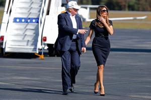 Republican presidential nominee Donald Trump (L) and his wife Melania Trump arrive for a campaign rally the Air Wilmington Hangar located at Wilmington International Airport November 5, 2016 in Wilmington, North Carolina. With less than a week before Election Day in the United States, Trump and his opponent, Democratic presidential nominee Hillary Clinton, are campaigning in key battleground states that each must win to take the White House.  (Photo by Chip Somodevilla/Getty Images)